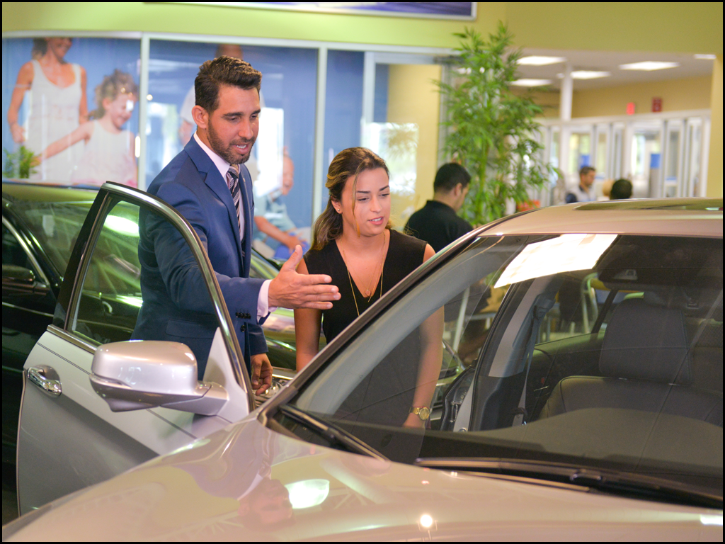 Salesman showing a women a vehicle