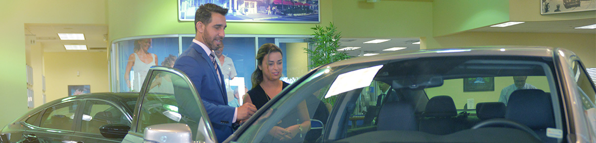 Salesman showing women a car
