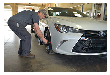 Elegant Bill Penney Toyota Service Advisor Works On A Vehicle