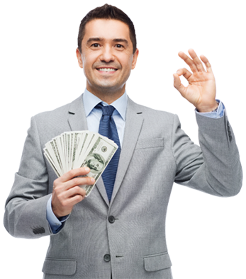 Man smiling giving the OK sign with his left hand and holding a stack of $100 bills in his right hand